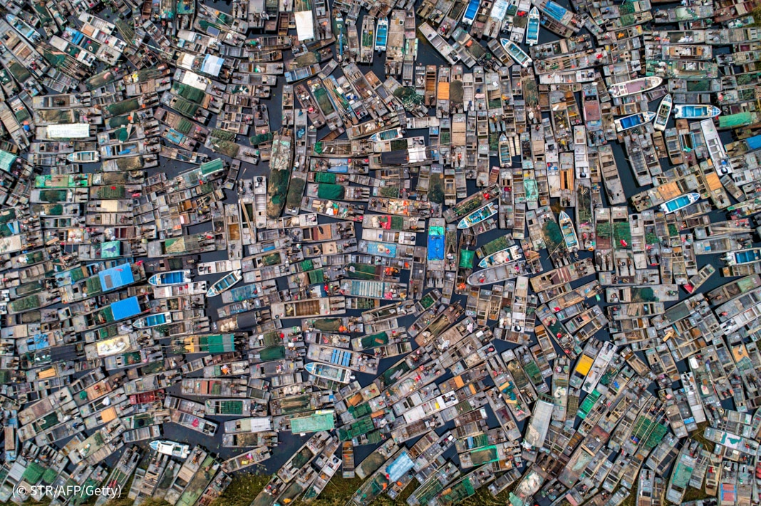 Overhead photo of many fishing boats crowded together (© STR/AFP/Getty)