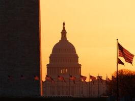 Washington Monument and U.S. Capitol at sunrise (© Carolyn Kaster/AP Images)