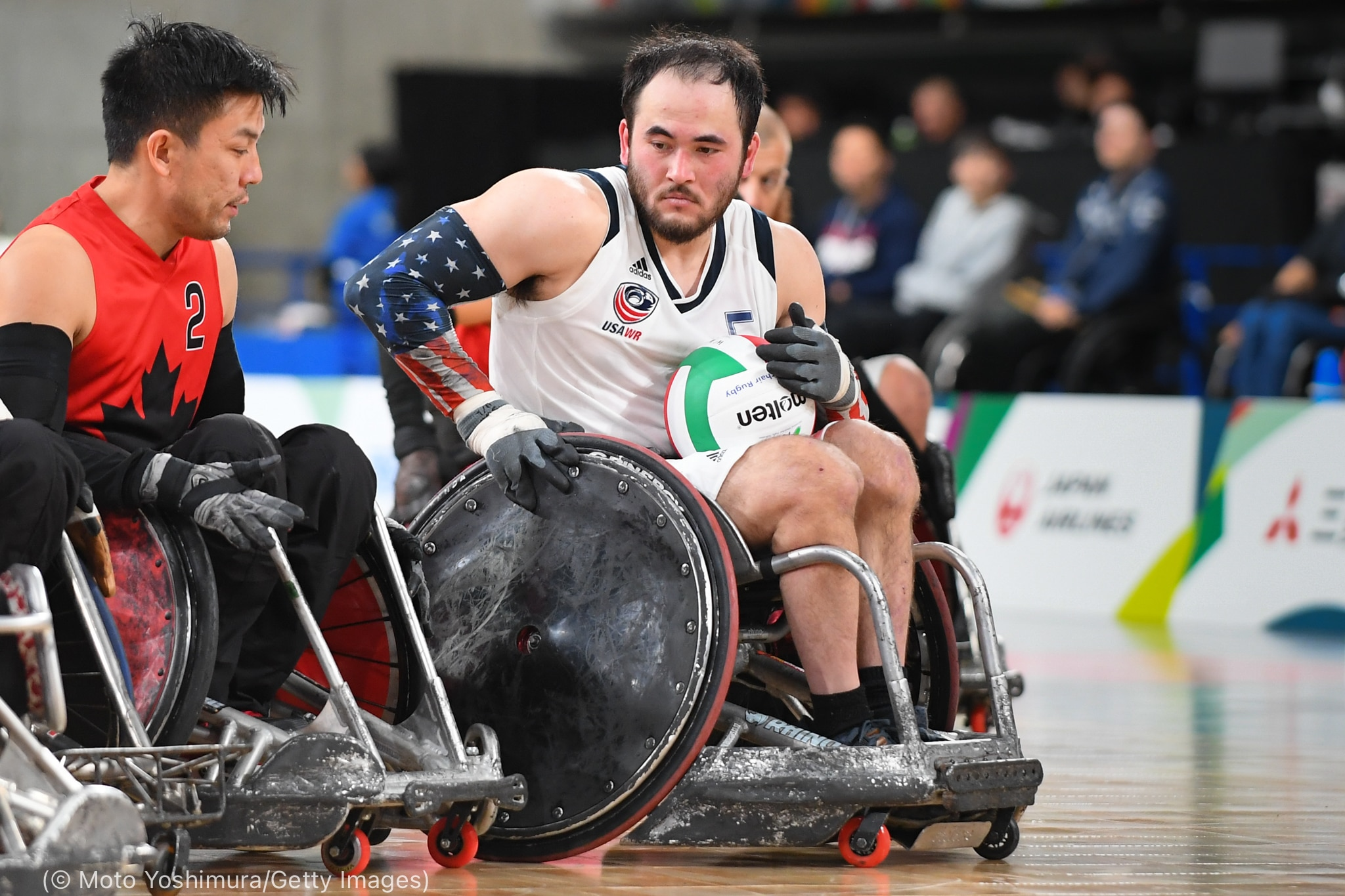 Men in wheelchairs playing rugby (© Moto Yoshimura/Getty Images)