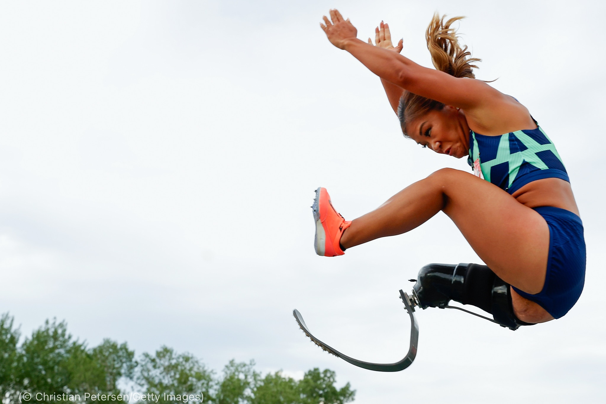 Woman jumping (© Christian Petersen/Getty Images)