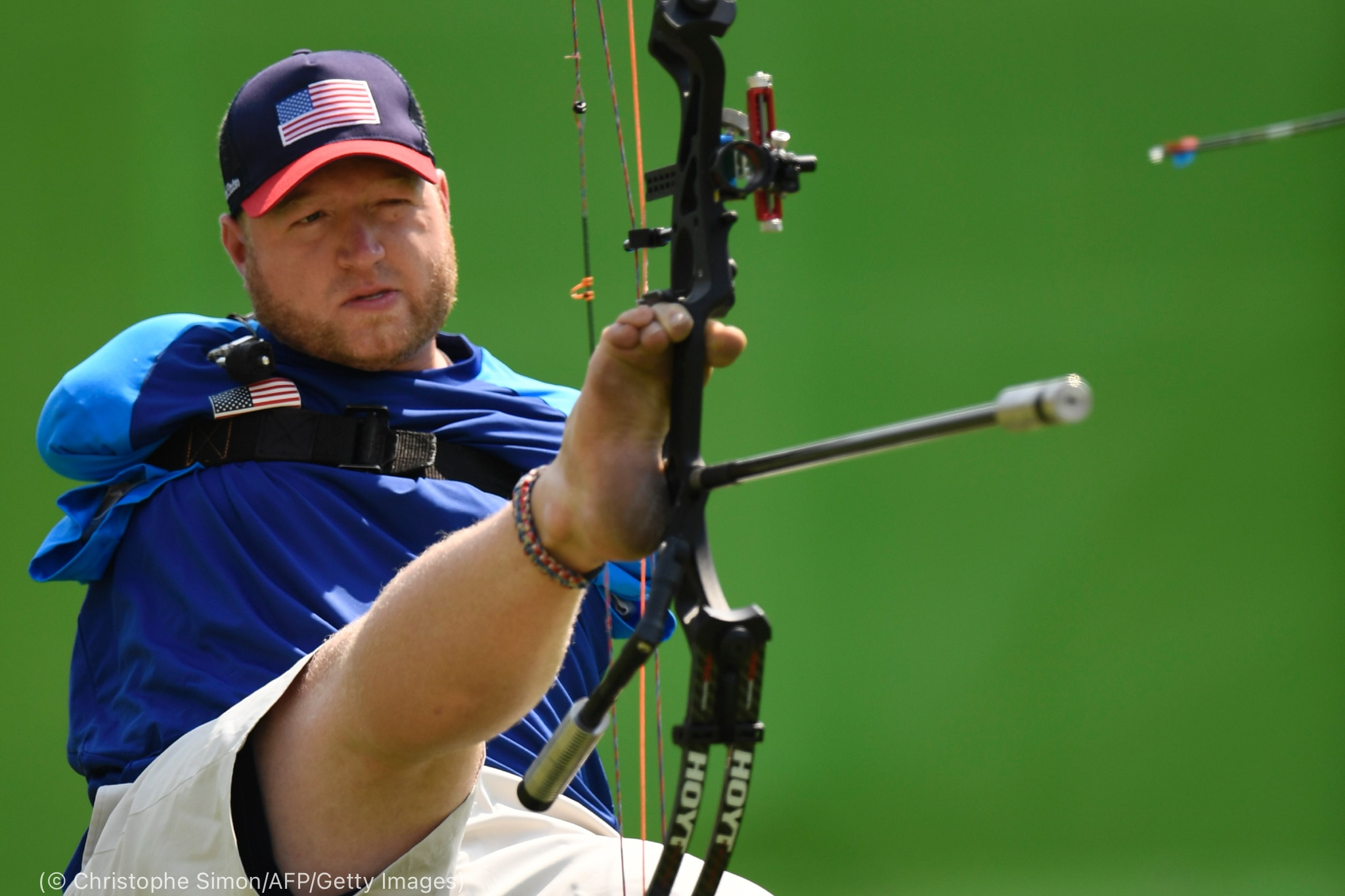 Man using his feet to do archery (© Christophe Simon/AFP/Getty Images)