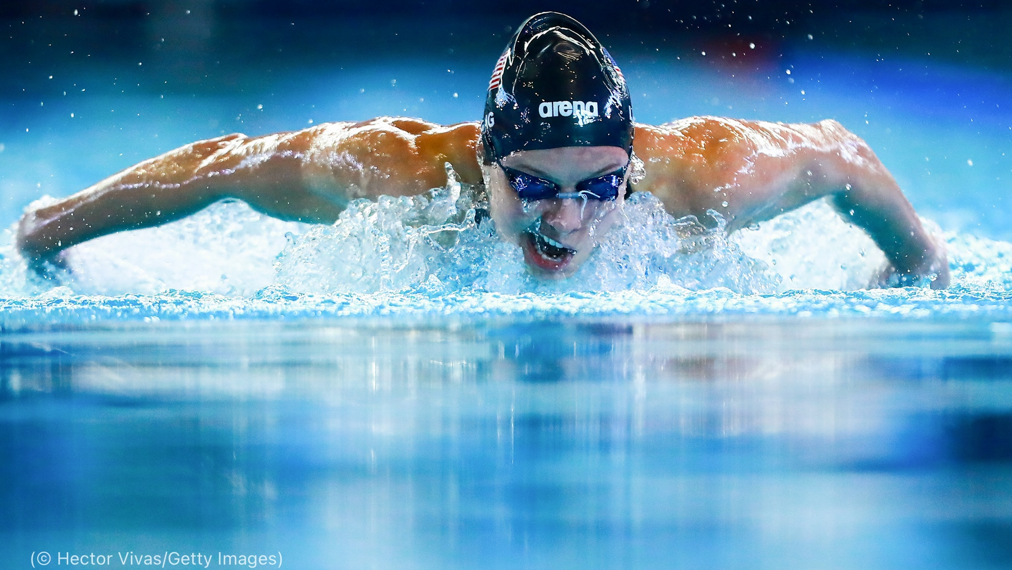 Woman swimming (© Hector Vivas/Getty Images)