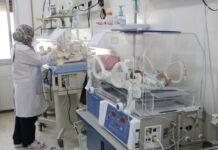 Woman checking on babies in incubators (Courtesy of Syrian American Medical Society/SAMS)