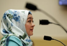 Woman wearing headscarf speaking into microphone (© Chip Somodevilla/Getty Images)