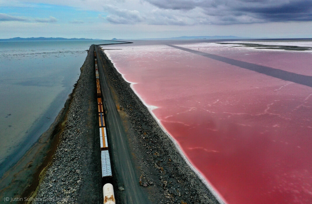 Aerial view of railroad train dividing two sections of water (© Justin Sullivan/Getty Images)