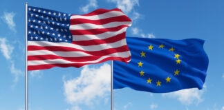 USA and European Union flags against a blue sky (© Shutterstock)