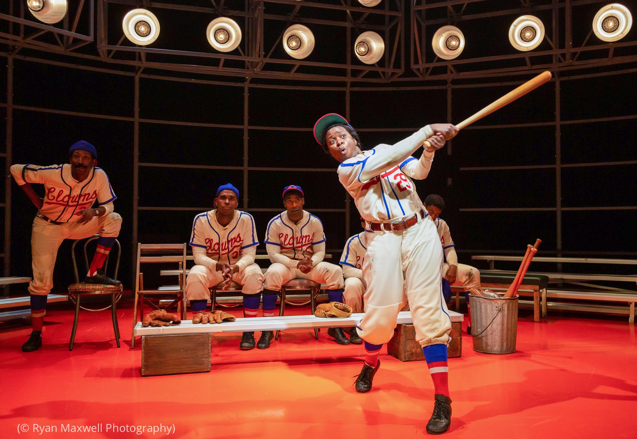 Female actor in baseball uniform swinging bat (© Ryan Maxwell Photography)