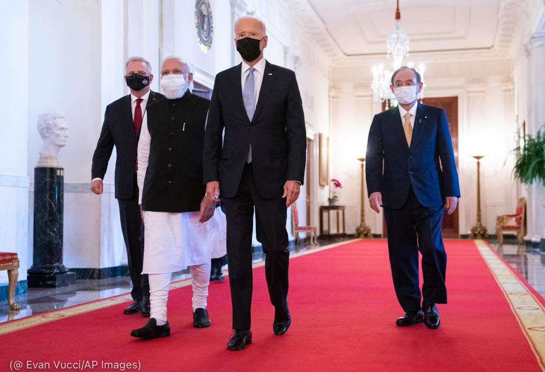 Four men walking down hallway (© Evan Vucci/AP Images)