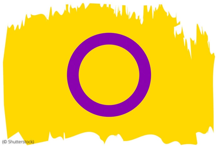 Intersex flag of open purple circle on yellow background (© Shutterstocck)